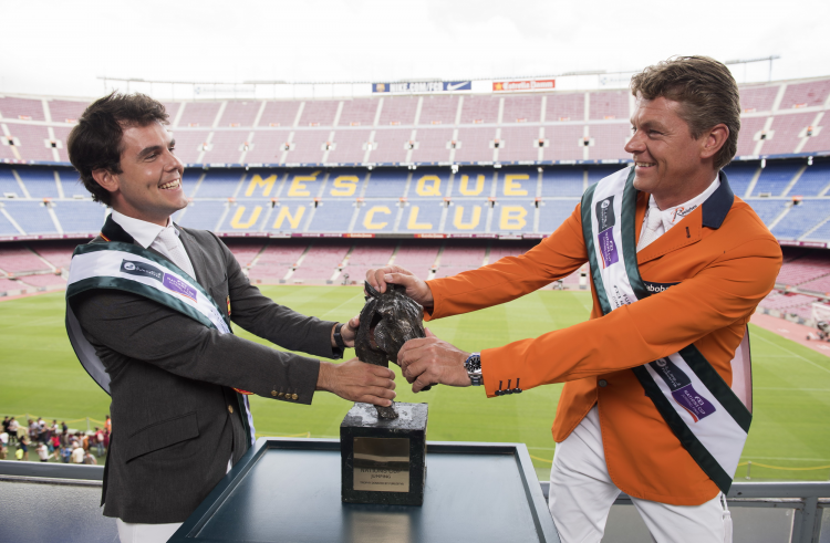 This could get messy! Sydney 2000 Olympic Jumping gold medallist and current World European champion Jeroen Dubbeldam (NED), right, and Sergio Álvarez Moya (ESP) wrestle with the Furusiyya trophy at FC Barcelona's iconic Camp Nou stadium in the countdown to the Furusiyya FEI Nations Cup™ Jumping Final at the neighbouring Real Club De Polo de Barcelona (24-27 September). (FEI/Dan Rowley)
