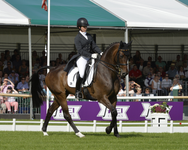 Photo caption: Bettina Hoy (GER) and Designer 10 produce a superb display at the Land Rover Burghley Horse Trials, final leg of the FEI Classics™ 2015/2016, to take a commanding lead after the first day of Dressage (Trevor Meeks/FEI)