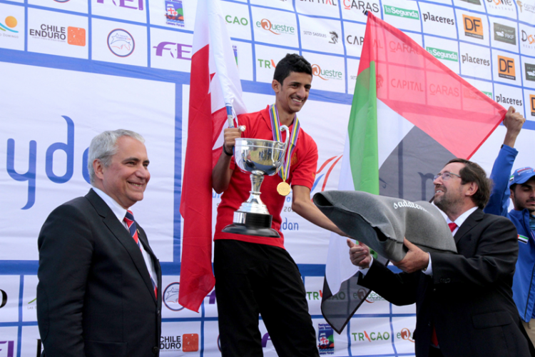 Individual gold medallist, Bahrain's Fahad Helal Mohamed Al Khatri, is congratulated by FEI President Ingmar de Vos and Cristian Herrera, Director of the Chilean Endurance Federation at the FEI World Endurance Championships for Juniors and Young Riders 2015 at Santo Domingo, Chile. (FEI/Rebecca Pearman)
