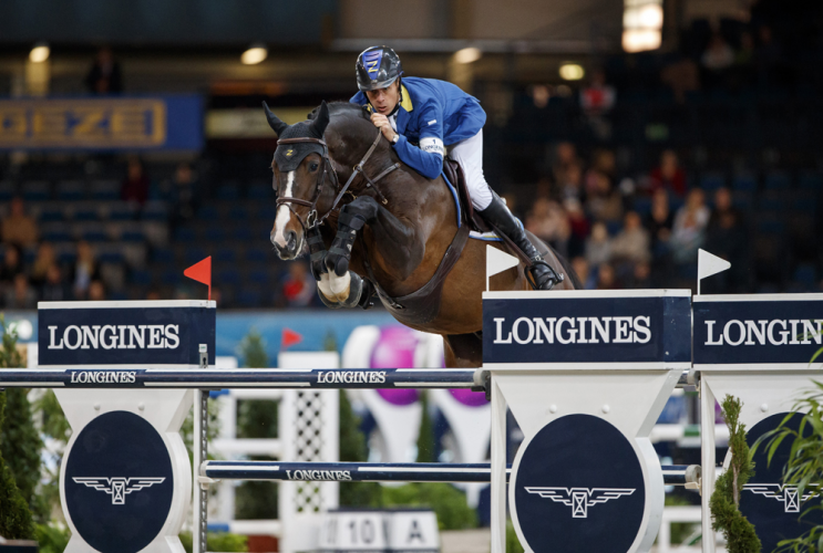 Tucking up his toes and jumping to perfection, Taloubet Z carried Germany's Christian Ahlmann to victory in the fifth leg of the Longines FEI World Cup™ Jumping 2016/2017 Western European League at Stuttgart, Germany today. (Stefan Lafrentz/FEI)