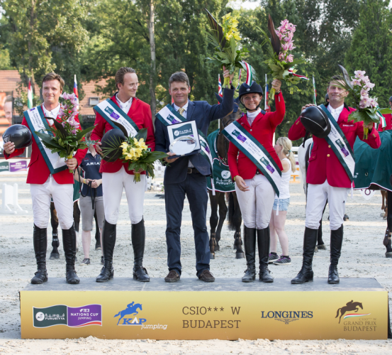 Team Denmark won the fifth leg of the Furusiyya FEI Nations Cup™ Jumping 2015 Europe Division 2 League at Budapest in Denmark today. Pictured (L to R) Thomas Sandgaard, Andreas Schou, Chef d'Equipe Lars Pedersen, Rikke Haastrup and Soren Pedersen. (FEI/Tomas Holbecher)