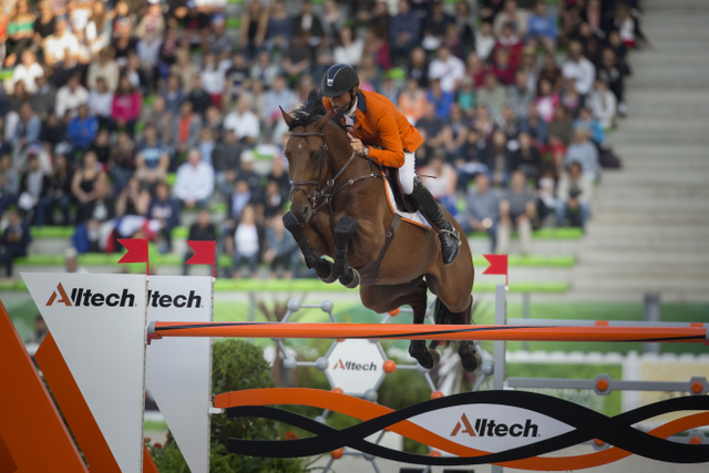 Caption: Jeroen Dubbeldam and Zenith SFN produced one of the three clears that promoted the Dutch team to pole position ahead of tomorrow's final round of the team Jumping championship at the Alltech FEI World Equestrian Games™ 2014 in Caen, France today. (Dirk Caremans/FEI)