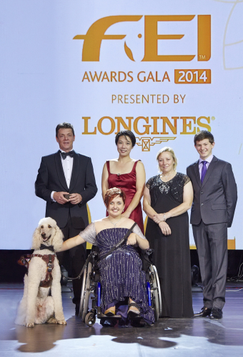 Equestrian heroes celebrated at the FEI Awards 2014, in association with Longines and with international fashion designer Reem Acra (left to right): Jeroen Dubbeldam (NED), Melissa Tan (SIN) chairman of equine therapy centre Equal Ark, Jackie Potts (GBR), Lambert Leclezio (MRI) with (centre) Sydney Collier (USA) and her service dog Journey. (FEI/Liz Gregg)