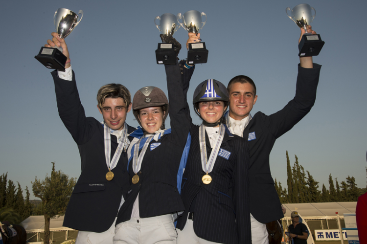 The newly-crowned Junior team gold medallists from Greece at the FEI Balkan Jumping Championships 2015 in Halkidiki, Sithonia, Greece last weekend. (L to R) Alexandros Kokkonis, Nikolina Makarona, Ioli Mytilineou and Konstantinos Papathanassiou. (FEI/Alexis Vassilopoulos)
