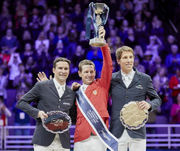 USA's double Olympic gold medallist, McLain Ward lifts the Longines FEI World Cup™ trophy for the first time on the winner's podium with Romain Duguet (SUI) in second and Henrik von Eckermann (SWE) third at the Final 2017 Omaha (USA) today. (Liz Gregg/FEI)