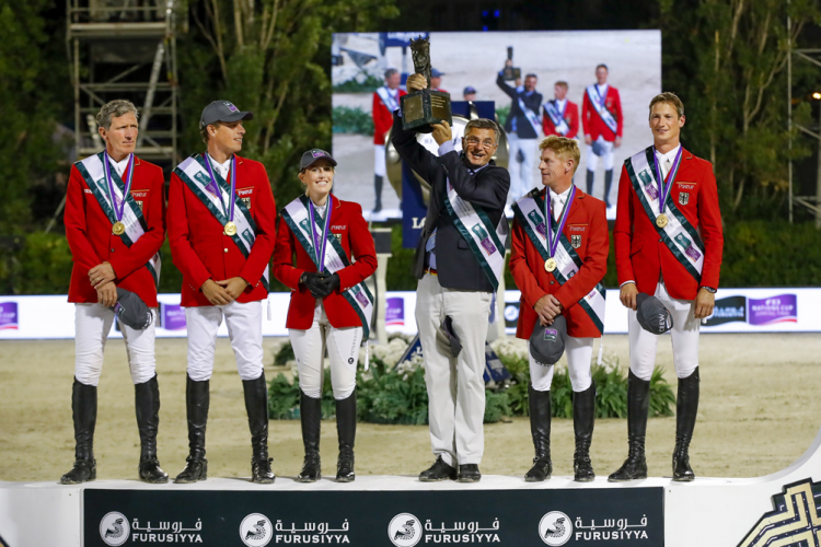 Team Germany, Furusiyya FEI Nations Cup™ 2016 champions, on the podium in Barcelona (ESP) tonight: (L to R) Ludger Beerbaum, Christian Ahlmann, Janne Friederike Meyer, Otto Becker (Chef d'Equipe), Marcus Ehning and Daniel Deusser. (Dirk Caremans/FEI)