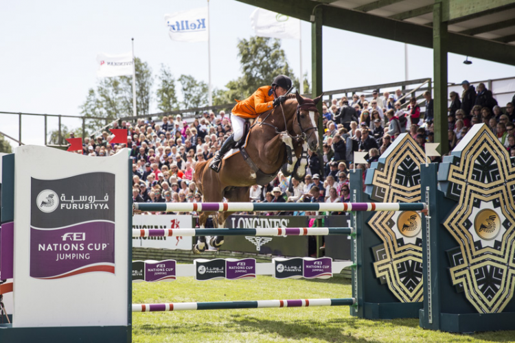 Harrie Smolders and Emerald were pathfinders for the Dutch team that won today's sixth leg of the Furusiyya FEI Nations Cup™ Jumping 2015 Europe Division 1 League at Falsterbo, Sweden with a zero score. (FEI/Lotta Gyllensten)