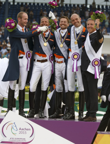 The Netherlands claimed the FEI European Dressage Championships 2015 team title at Aachen, Germany today. On the podium: Diederik van Silfhout, Patrick van der Meer, Edward Gal, Hans Peter Minderhoud and Chef d'Equipe Wim Ernes. (FEI/Dirk Caremans)