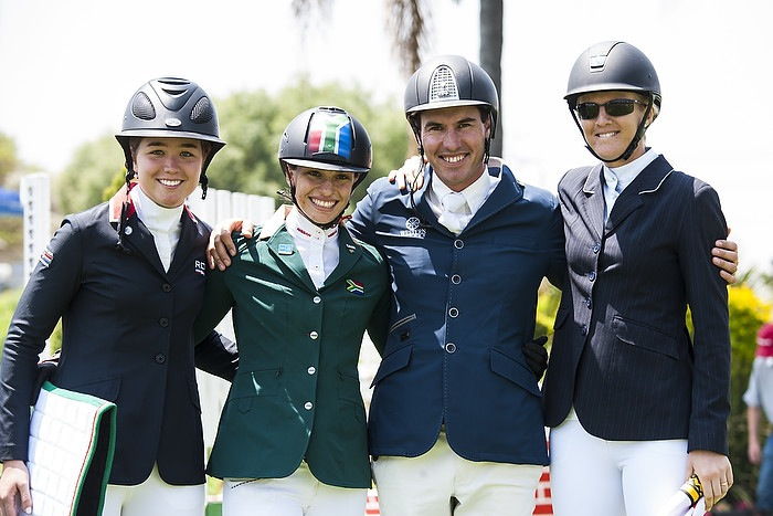 On the podium at the FEI World Jumping Challenge Final 2014 in Kyalami (RSA) left to right: silver medallist Maria Gabriela Brugal (DOM), Alexa Stais (RSA) who finished fourth, Rainer Korber (RSA) who took bronze and gold medallist Charley Crockart (ZIM). (FEI/Tamara Blake Images).