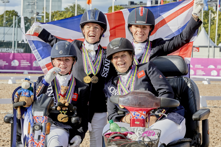 Great Britain take gold in the Para Dressage Team Competition at the Longines FEI European Championships 2017 in Gothenburg, Sweden. From left to right: Susanna Hext (Grade III), Erin Orford (Grade III), Julie Payne (Grade I) and Sophie Wells (Grade V). (FEI/Liz Gregg)